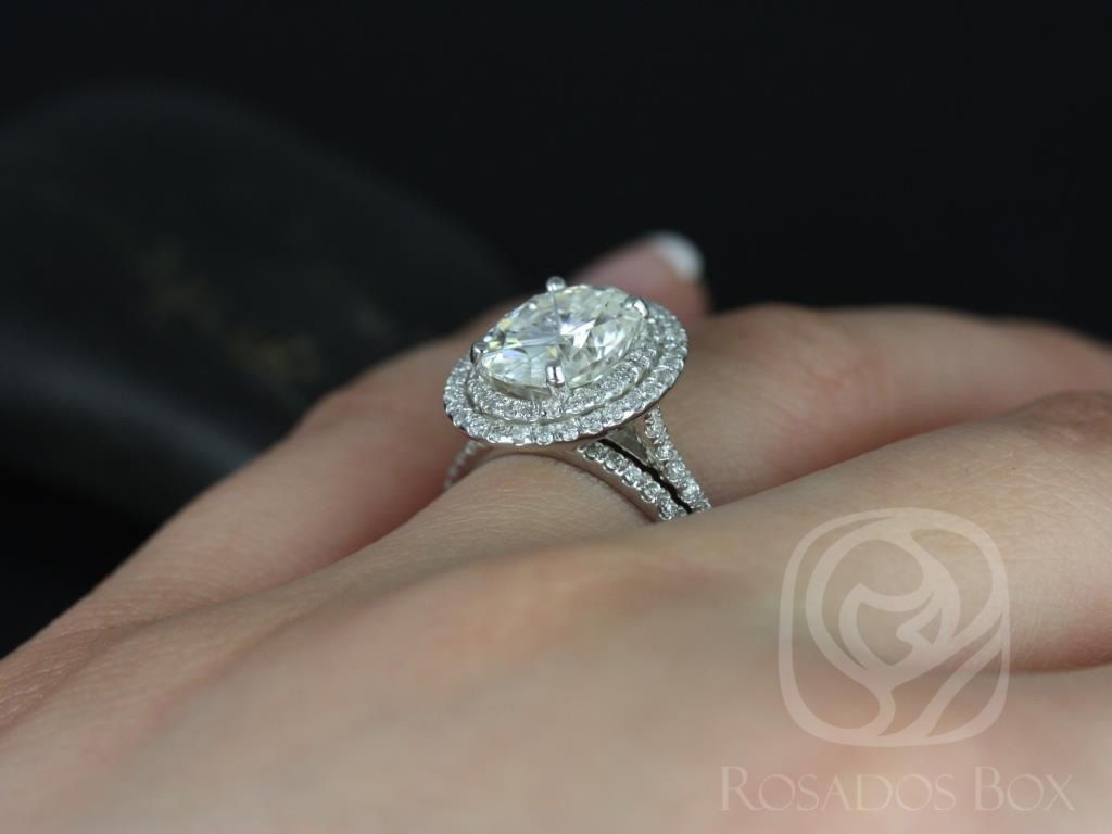 https://www.loveandpromisejewelers.com/media/catalog/product/cache/feefdef027ccf0d59dd1fef51db0610e/c/a/cara_10x8mm_14kt_white_gold_oval_fb_moissanite_and_diamonds_double_halo_classic_wedding_set_4wm_.jpg