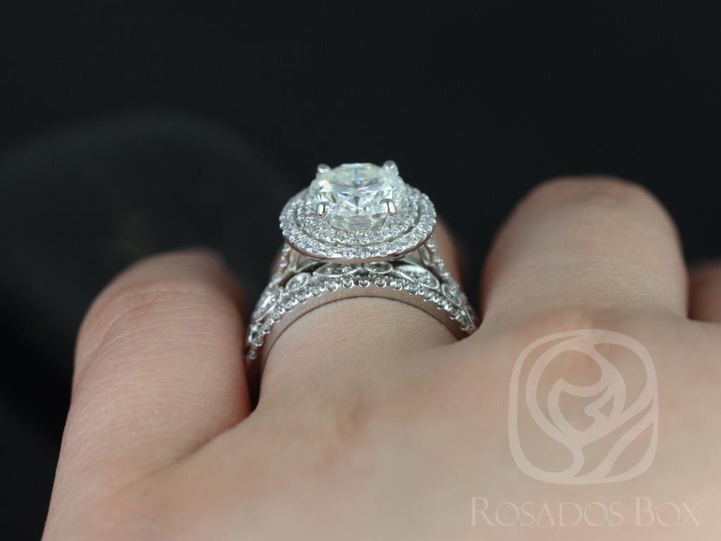 https://www.loveandpromisejewelers.com/media/catalog/product/cache/feefdef027ccf0d59dd1fef51db0610e/c/a/cara_10x8mm_madeline_14kt_white_gold_oval_fb_moissanite_and_diamonds_halo_trio_wedding_set_3wm_.jpg