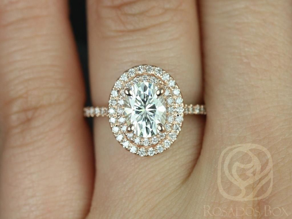 https://www.loveandpromisejewelers.com/media/catalog/product/cache/feefdef027ccf0d59dd1fef51db0610e/c/a/cara_8x6mm_14kt_rose_gold_oval_fb_moissanite_and_diamonds_double_halo_engagement_ring_other_metals_and_stone_options_available_3wm.jpg