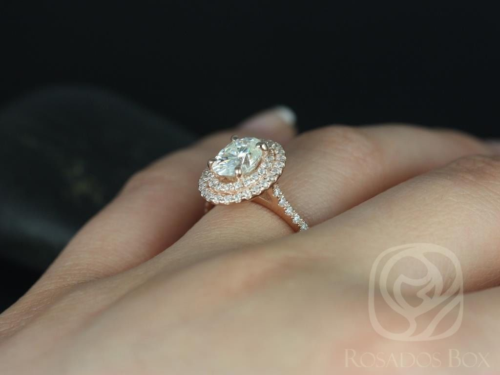 https://www.loveandpromisejewelers.com/media/catalog/product/cache/feefdef027ccf0d59dd1fef51db0610e/c/a/cara_8x6mm_14kt_rose_gold_oval_fb_moissanite_and_diamonds_double_halo_engagement_ring_other_metals_and_stone_options_available_5wm.jpg