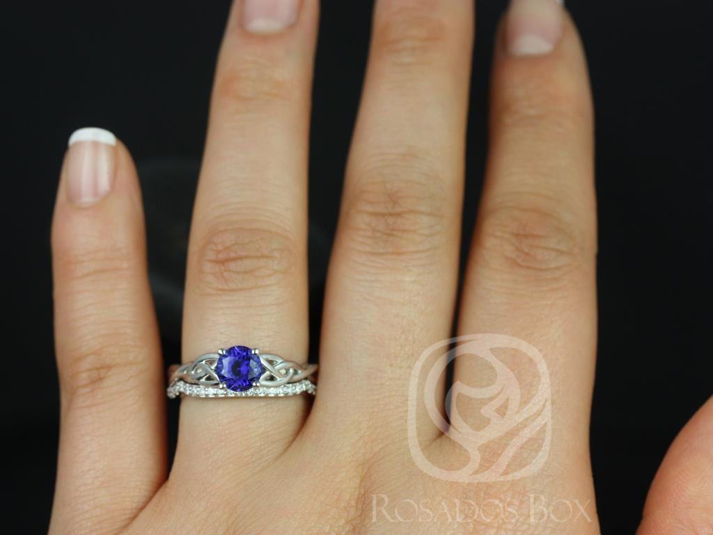 https://www.loveandpromisejewelers.com/media/catalog/product/cache/feefdef027ccf0d59dd1fef51db0610e/c/a/cassidy_14kt_white_gold_round_blue_sapphire_diamond_celtic_knot_wedding_set_3wm_.jpg