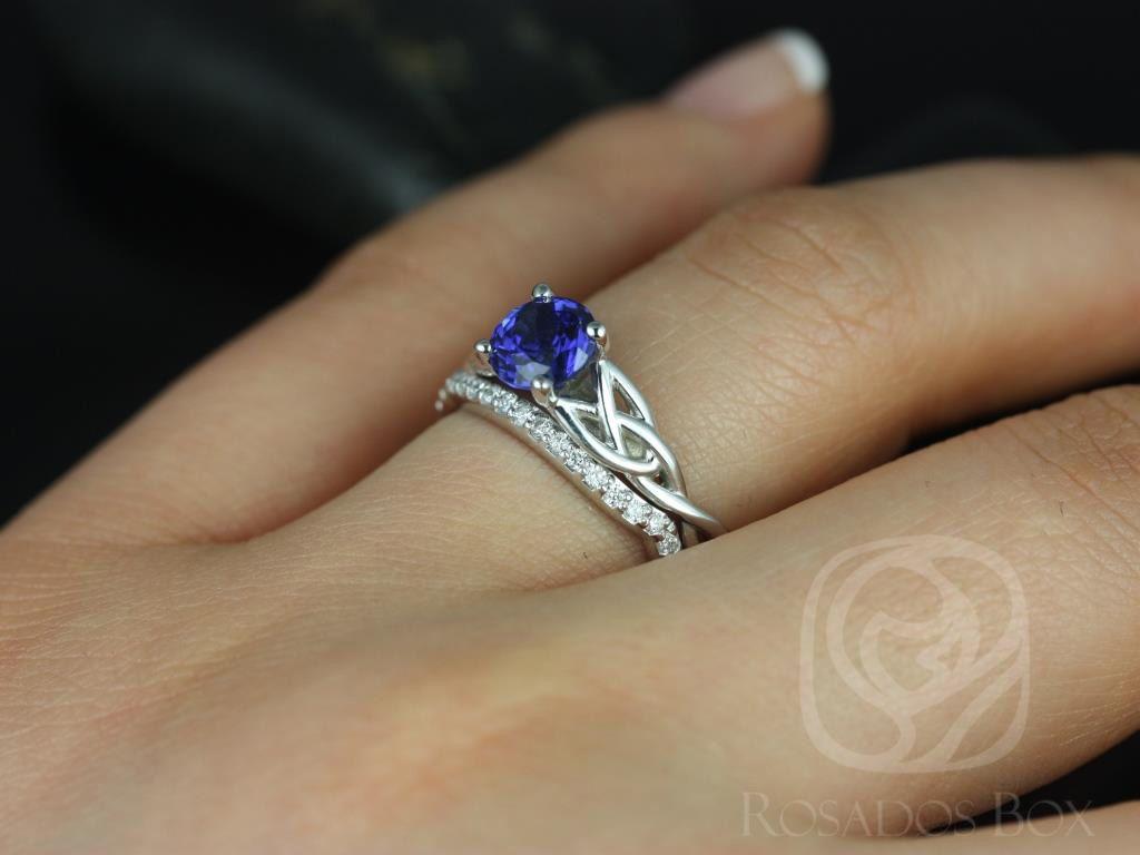 https://www.loveandpromisejewelers.com/media/catalog/product/cache/feefdef027ccf0d59dd1fef51db0610e/c/a/cassidy_14kt_white_gold_round_blue_sapphire_diamond_celtic_knot_wedding_set_4wm_.jpg