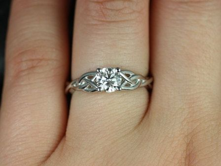 https://www.loveandpromisejewelers.com/media/catalog/product/cache/feefdef027ccf0d59dd1fef51db0610e/c/a/cassidy_34ct_14kt_white_gold_round_diamond_celtic_knot_engagement_ring_2.jpg