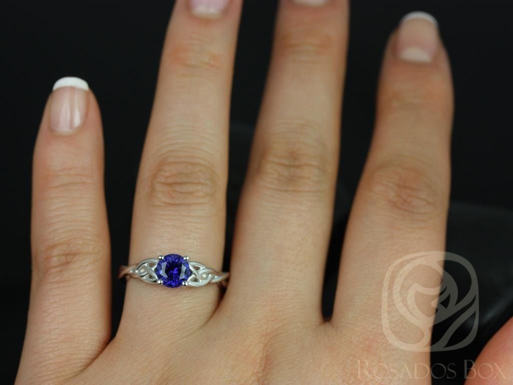 https://www.loveandpromisejewelers.com/media/catalog/product/cache/feefdef027ccf0d59dd1fef51db0610e/c/a/cassidy_6mm_14kt_white_gold_round_blue_sapphire_celtic_knot_engagement_ring_other_metals_and_stone_options_available_3wm.jpg