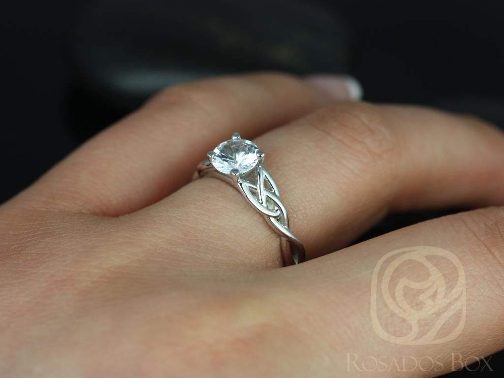https://www.loveandpromisejewelers.com/media/catalog/product/cache/feefdef027ccf0d59dd1fef51db0610e/c/a/cassidy_6mm_14kt_white_gold_round_white_sapphire_celtic_knot_engagement_ring_other_metals_and_stone_options_available_1wm_1.jpg