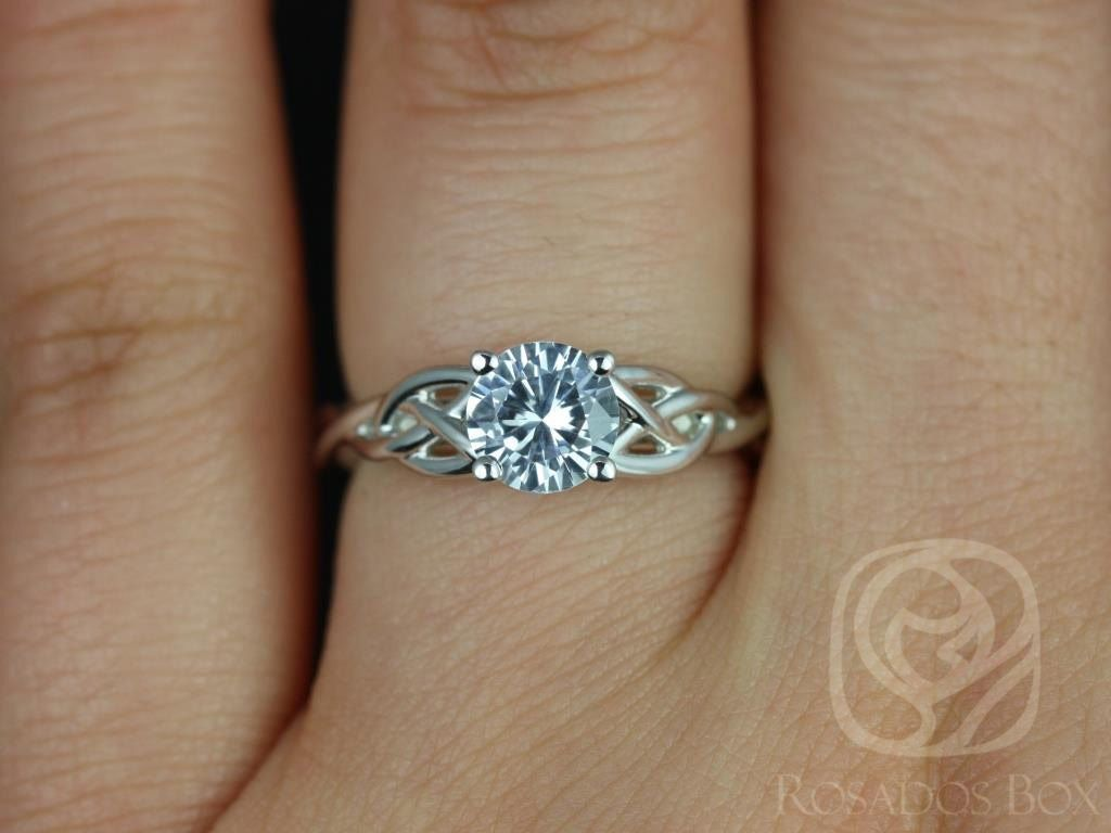 https://www.loveandpromisejewelers.com/media/catalog/product/cache/feefdef027ccf0d59dd1fef51db0610e/c/a/cassidy_6mm_14kt_white_gold_round_white_sapphire_celtic_knot_engagement_ring_other_metals_and_stone_options_available_3wm_1.jpg