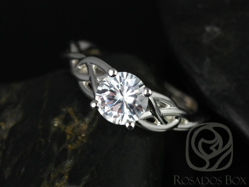 https://www.loveandpromisejewelers.com/media/catalog/product/cache/feefdef027ccf0d59dd1fef51db0610e/c/a/cassidy_6mm_14kt_white_gold_round_white_sapphire_celtic_knot_engagement_ring_other_metals_and_stone_options_available_4wm_1.jpg