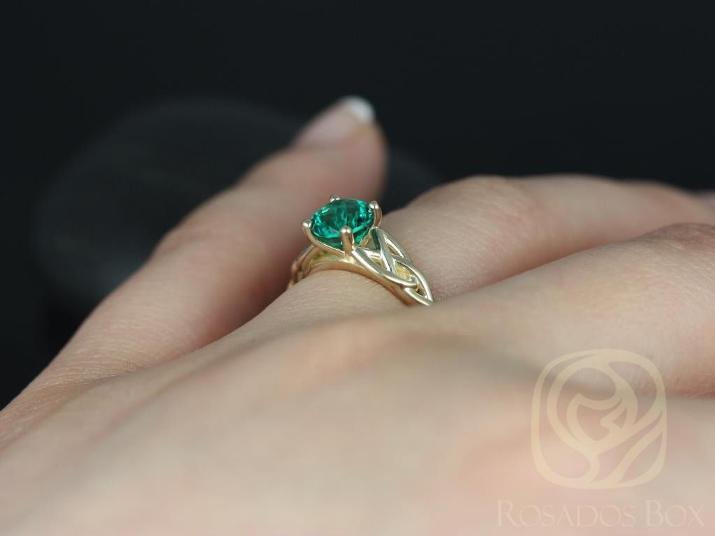 https://www.loveandpromisejewelers.com/media/catalog/product/cache/feefdef027ccf0d59dd1fef51db0610e/c/a/cassidy_6mm_14kt_yellow_gold_round_emerald_celtic_knot_engagement_ring_other_metals_and_stone_options_available_5wm.jpg