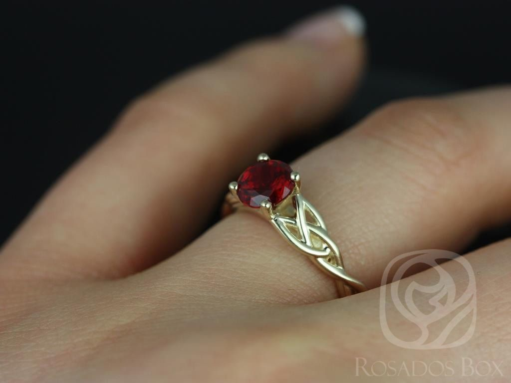 https://www.loveandpromisejewelers.com/media/catalog/product/cache/feefdef027ccf0d59dd1fef51db0610e/c/a/cassidy_6mm_14kt_yellow_gold_round_ruby_celtic_knot_engagement_ring_other_metals_and_stone_options_available_1wm.jpg