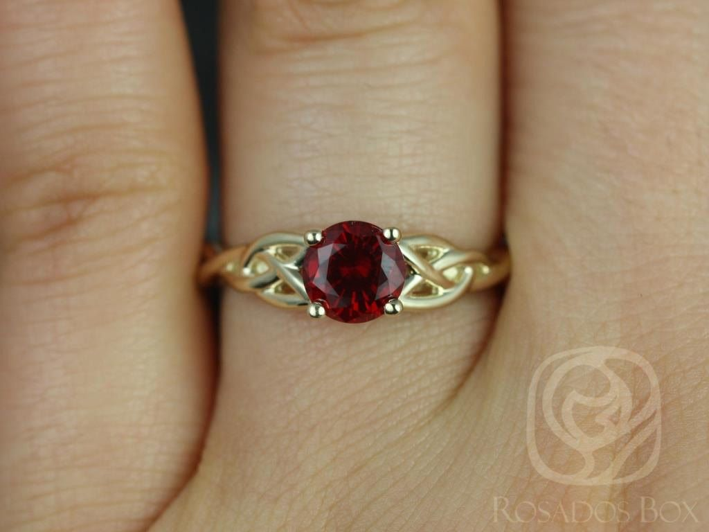 https://www.loveandpromisejewelers.com/media/catalog/product/cache/feefdef027ccf0d59dd1fef51db0610e/c/a/cassidy_6mm_14kt_yellow_gold_round_ruby_celtic_knot_engagement_ring_other_metals_and_stone_options_available_2wm.jpg