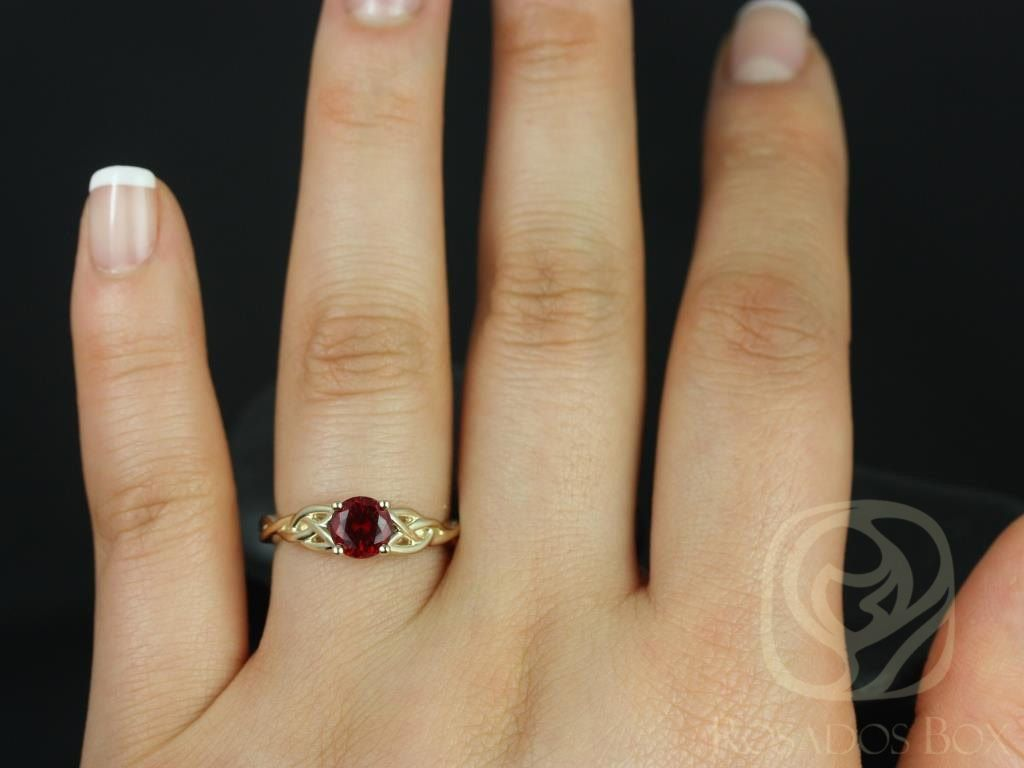 https://www.loveandpromisejewelers.com/media/catalog/product/cache/feefdef027ccf0d59dd1fef51db0610e/c/a/cassidy_6mm_14kt_yellow_gold_round_ruby_celtic_knot_engagement_ring_other_metals_and_stone_options_available_3wm.jpg