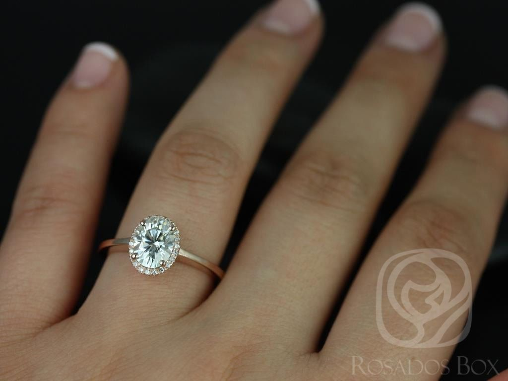 https://www.loveandpromisejewelers.com/media/catalog/product/cache/feefdef027ccf0d59dd1fef51db0610e/c/e/celeste_8x6mm_14kt_rose_gold_oval_fb_moissanite_and_diamonds_pave_halo_engagement_ring_other_metals_and_stone_options_available_4wm.jpg