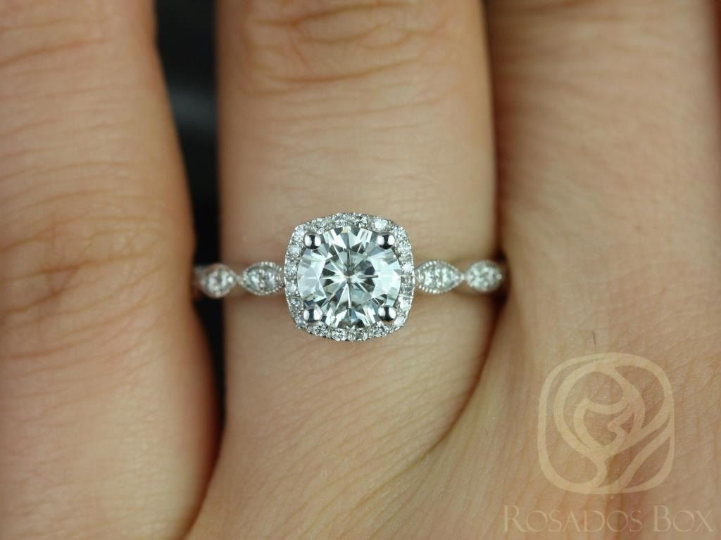 https://www.loveandpromisejewelers.com/media/catalog/product/cache/feefdef027ccf0d59dd1fef51db0610e/c/h/christie_6mm_14kt_white_gold_round_fb_moissanite_and_diamonds_cushion_halo_with_milgrain_engagement_ring_other_metals_and_stone_available_3wm.jpg