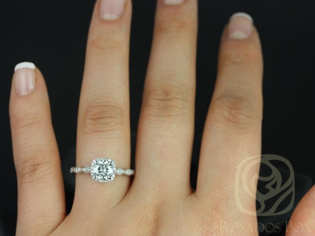 https://www.loveandpromisejewelers.com/media/catalog/product/cache/feefdef027ccf0d59dd1fef51db0610e/c/h/christie_6mm_14kt_white_gold_round_fb_moissanite_and_diamonds_cushion_halo_with_milgrain_engagement_ring_other_metals_and_stone_available_4wm.jpg