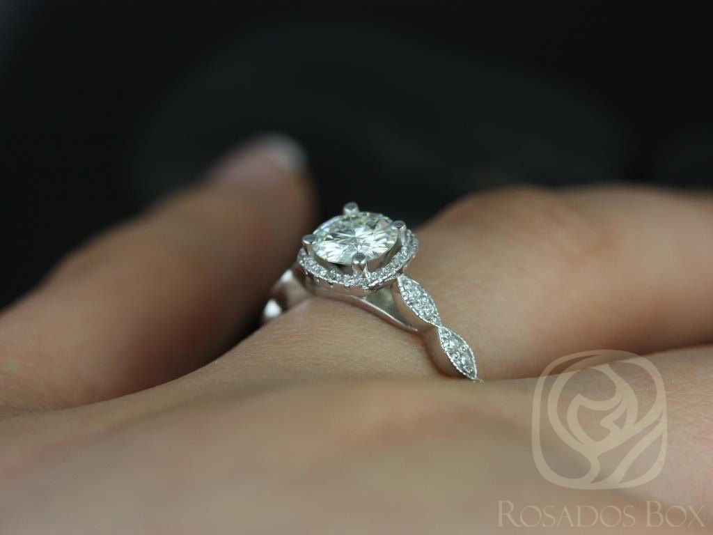 https://www.loveandpromisejewelers.com/media/catalog/product/cache/feefdef027ccf0d59dd1fef51db0610e/c/h/christie_6mm_14kt_white_gold_round_fb_moissanite_and_diamonds_cushion_halo_with_milgrain_engagement_ring_other_metals_and_stone_available_5wm.jpg