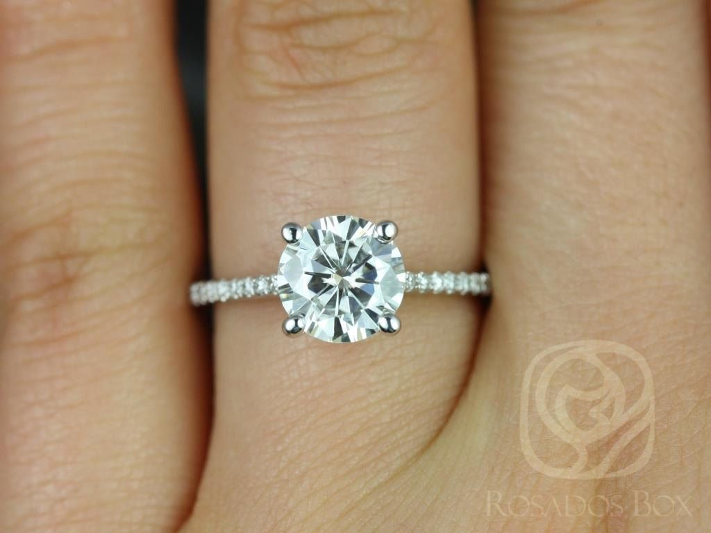 https://www.loveandpromisejewelers.com/media/catalog/product/cache/feefdef027ccf0d59dd1fef51db0610e/e/l/eloise_7.5mm_size_14kt_white_gold_round_fb_moissanite_and_diamonds_cathedral_engagement_ring_3wm.jpg