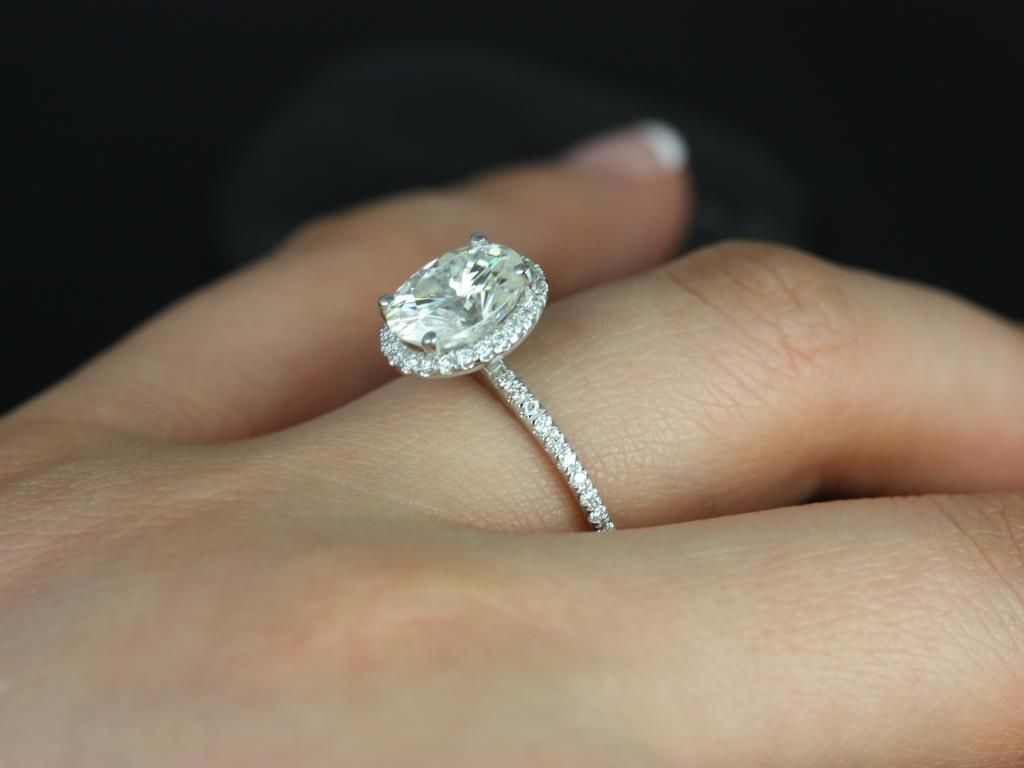 https://www.loveandpromisejewelers.com/media/catalog/product/cache/feefdef027ccf0d59dd1fef51db0610e/f/e/federella_medio_size_14kt_white_gold_oval_fb_moissanite_and_diamond_halo_engagement_ring_1_.jpg