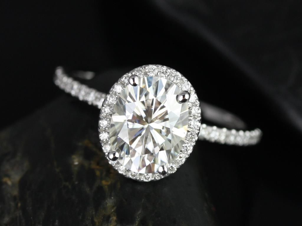 https://www.loveandpromisejewelers.com/media/catalog/product/cache/feefdef027ccf0d59dd1fef51db0610e/f/e/federella_medio_size_14kt_white_gold_oval_fb_moissanite_and_diamond_halo_engagement_ring_2_.jpg