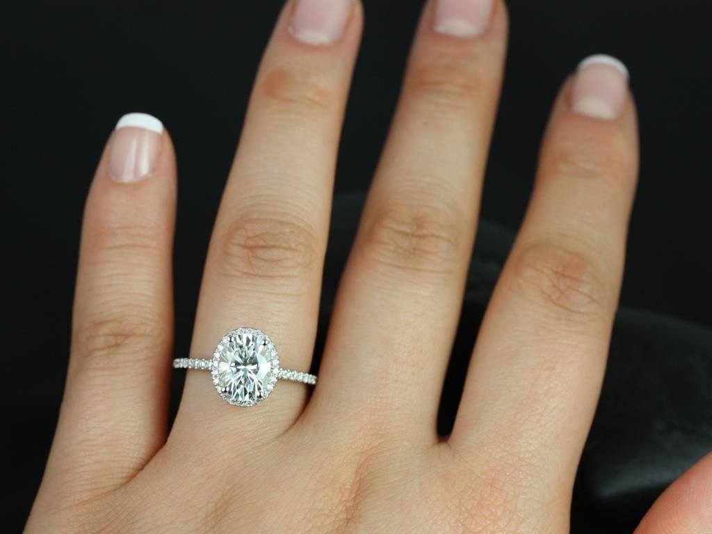https://www.loveandpromisejewelers.com/media/catalog/product/cache/feefdef027ccf0d59dd1fef51db0610e/f/e/federella_medio_size_14kt_white_gold_oval_fb_moissanite_and_diamond_halo_engagement_ring_5_.jpg