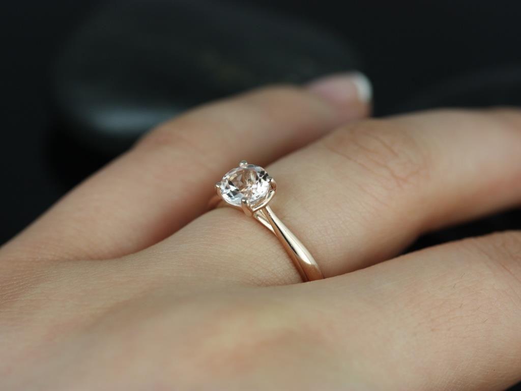 https://www.loveandpromisejewelers.com/media/catalog/product/cache/feefdef027ccf0d59dd1fef51db0610e/f/l/flora_morganite_rose_gold_engagement_ring_1_.jpg