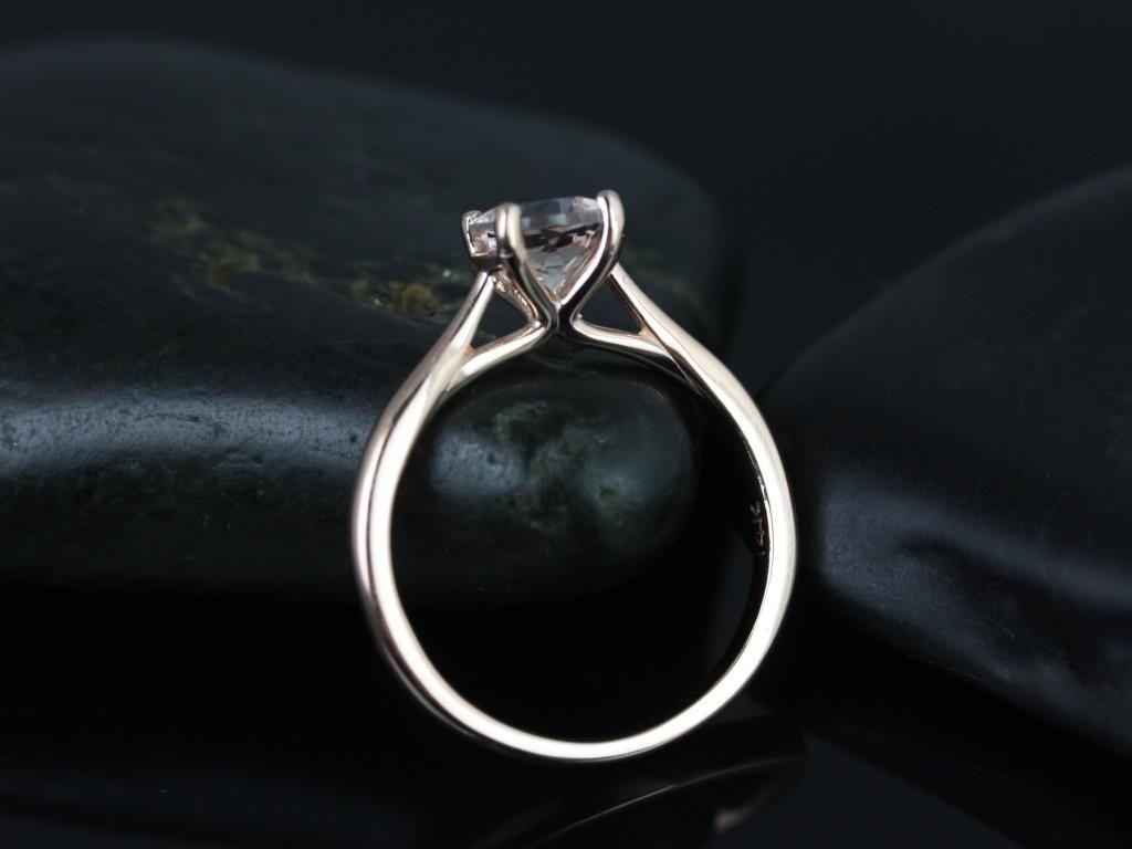 https://www.loveandpromisejewelers.com/media/catalog/product/cache/feefdef027ccf0d59dd1fef51db0610e/f/l/flora_morganite_rose_gold_engagement_ring_3_.jpg