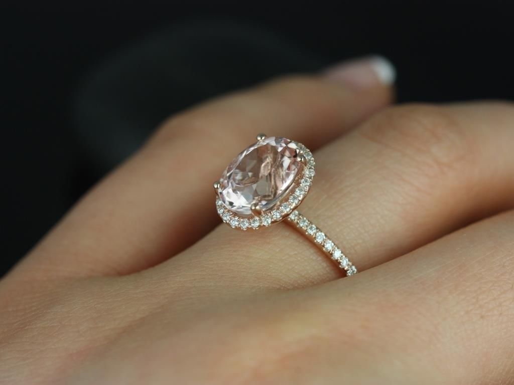 https://www.loveandpromisejewelers.com/media/catalog/product/cache/feefdef027ccf0d59dd1fef51db0610e/j/e/jessica_original_size_14kt_rose_gold_oval_morganite_and_diamonds_halo_engagement_ring_1__1.jpg
