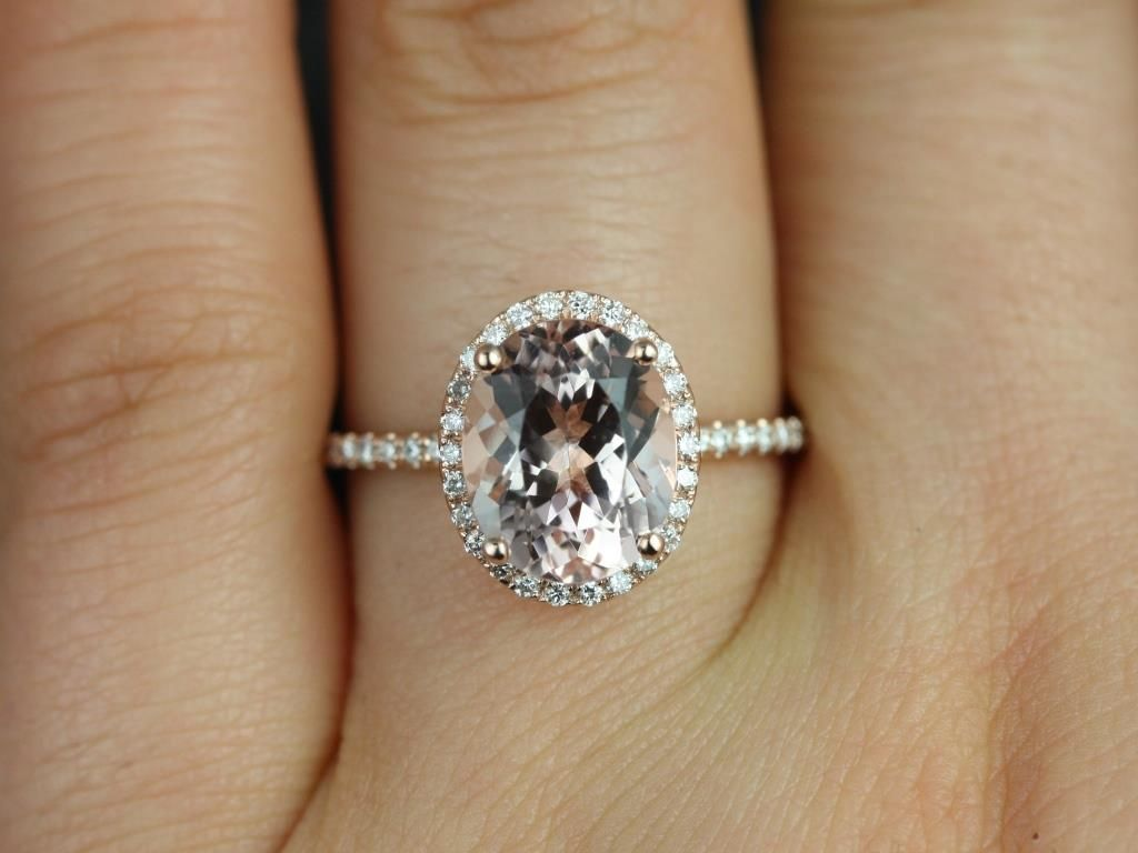 https://www.loveandpromisejewelers.com/media/catalog/product/cache/feefdef027ccf0d59dd1fef51db0610e/j/e/jessica_original_size_14kt_rose_gold_oval_morganite_and_diamonds_halo_engagement_ring_4__1.jpg