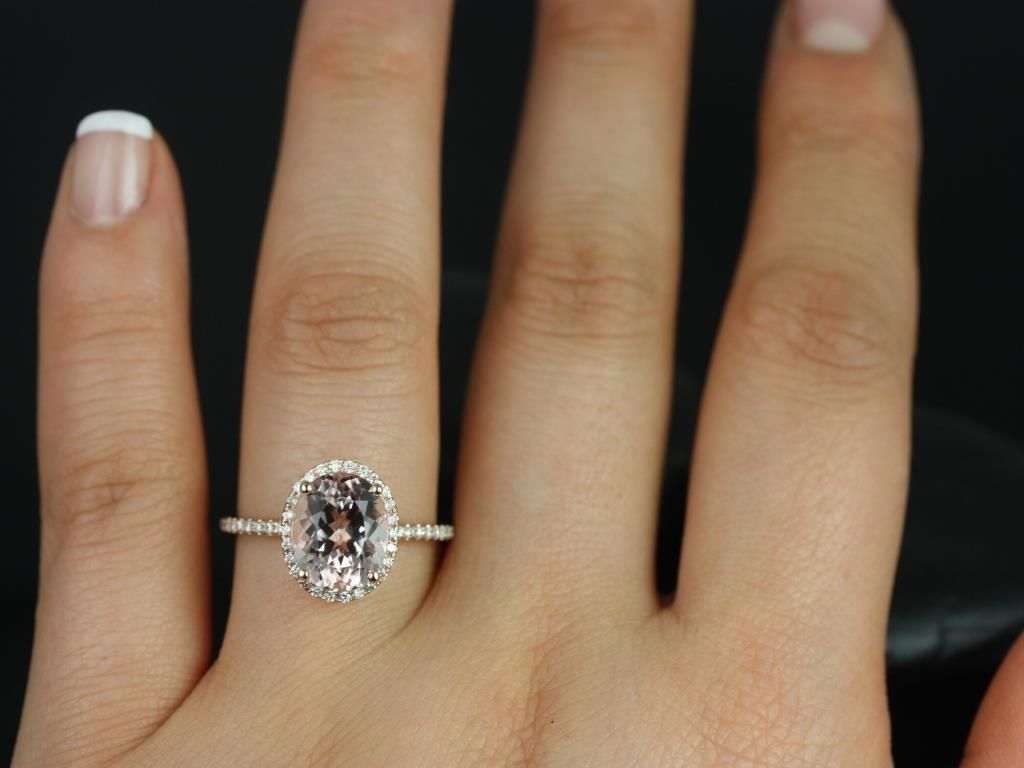 https://www.loveandpromisejewelers.com/media/catalog/product/cache/feefdef027ccf0d59dd1fef51db0610e/j/e/jessica_original_size_14kt_rose_gold_oval_morganite_and_diamonds_halo_engagement_ring_5__1.jpg