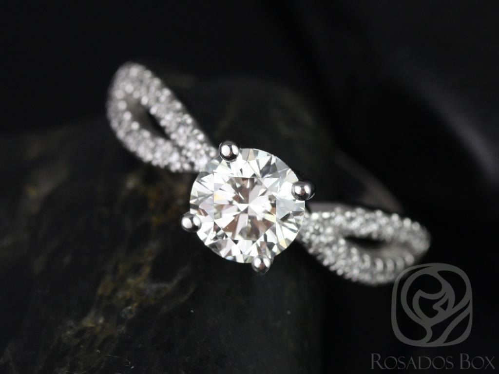 https://www.loveandpromisejewelers.com/media/catalog/product/cache/feefdef027ccf0d59dd1fef51db0610e/k/a/karina_7mm_14kt_white_gold_round_round_fb_moissanite_and_diamonds_twist_engagement_ring_1.jpg