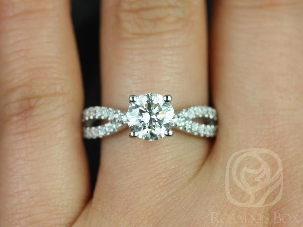 https://www.loveandpromisejewelers.com/media/catalog/product/cache/feefdef027ccf0d59dd1fef51db0610e/k/a/karina_7mm_14kt_white_gold_round_round_fb_moissanite_and_diamonds_twist_engagement_ring_3.jpg