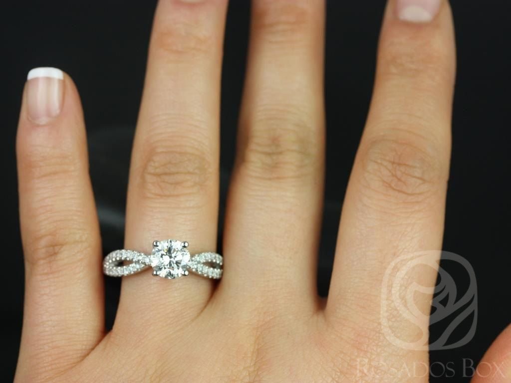 https://www.loveandpromisejewelers.com/media/catalog/product/cache/feefdef027ccf0d59dd1fef51db0610e/k/a/karina_7mm_14kt_white_gold_round_round_fb_moissanite_and_diamonds_twist_engagement_ring_4.jpg