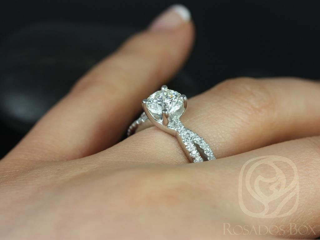 https://www.loveandpromisejewelers.com/media/catalog/product/cache/feefdef027ccf0d59dd1fef51db0610e/k/a/karina_7mm_14kt_white_gold_round_round_fb_moissanite_and_diamonds_twist_engagement_ring_5.jpg