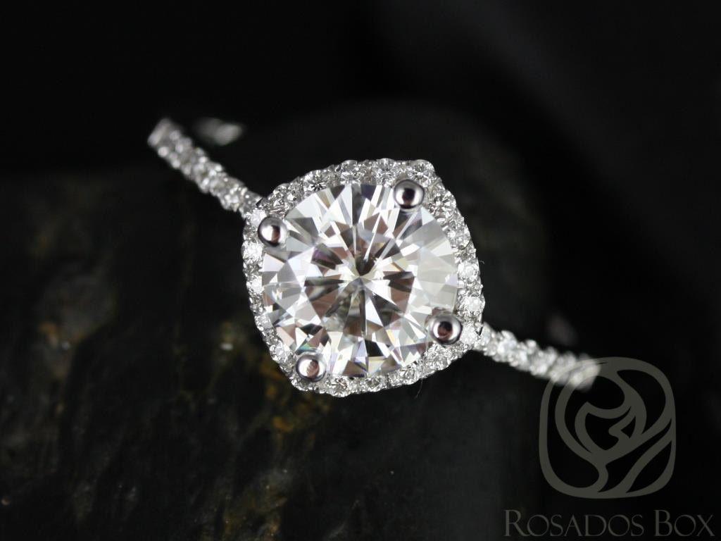 https://www.loveandpromisejewelers.com/media/catalog/product/cache/feefdef027ccf0d59dd1fef51db0610e/k/i/kitana_7mm_original_size_14kt_white_gold_thin_fb_moissanite_and_diamonds_cushion_halo_engagement_ring_1wm.jpg