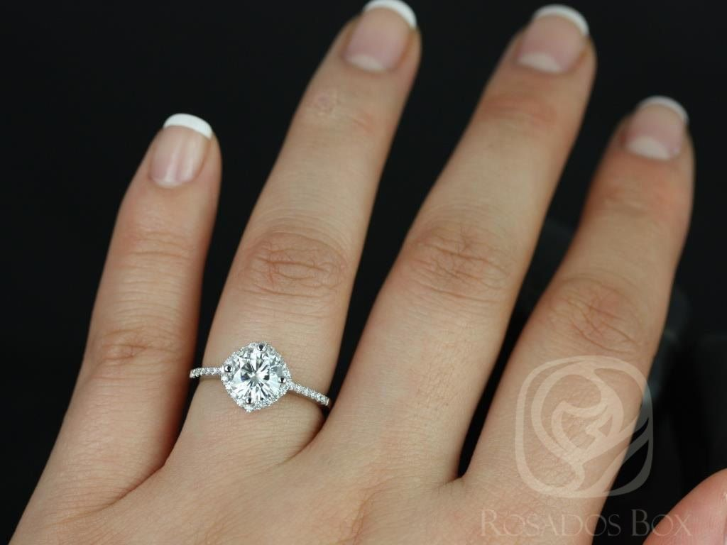 https://www.loveandpromisejewelers.com/media/catalog/product/cache/feefdef027ccf0d59dd1fef51db0610e/k/i/kitana_7mm_original_size_14kt_white_gold_thin_fb_moissanite_and_diamonds_cushion_halo_engagement_ring_4wm.jpg