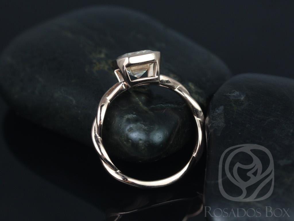 https://www.loveandpromisejewelers.com/media/catalog/product/cache/feefdef027ccf0d59dd1fef51db0610e/l/e/leslie_9x7mm_14kt_rose_gold_emerald_fb_moissanite_bezel_twist_engagement_ring2wm.jpg
