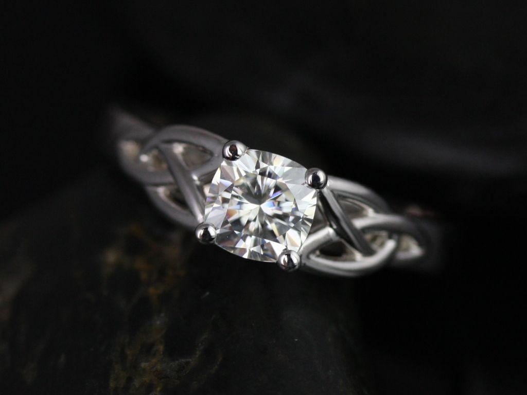 https://www.loveandpromisejewelers.com/media/catalog/product/cache/feefdef027ccf0d59dd1fef51db0610e/m/c/mccara_medio_size_fb_cushion_moissanite_white_gold_engagement_ring_2_.jpg