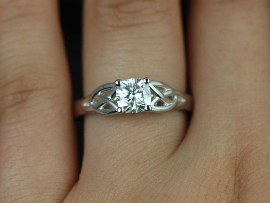 https://www.loveandpromisejewelers.com/media/catalog/product/cache/feefdef027ccf0d59dd1fef51db0610e/m/c/mccara_medio_size_fb_cushion_moissanite_white_gold_engagement_ring_4_.jpg