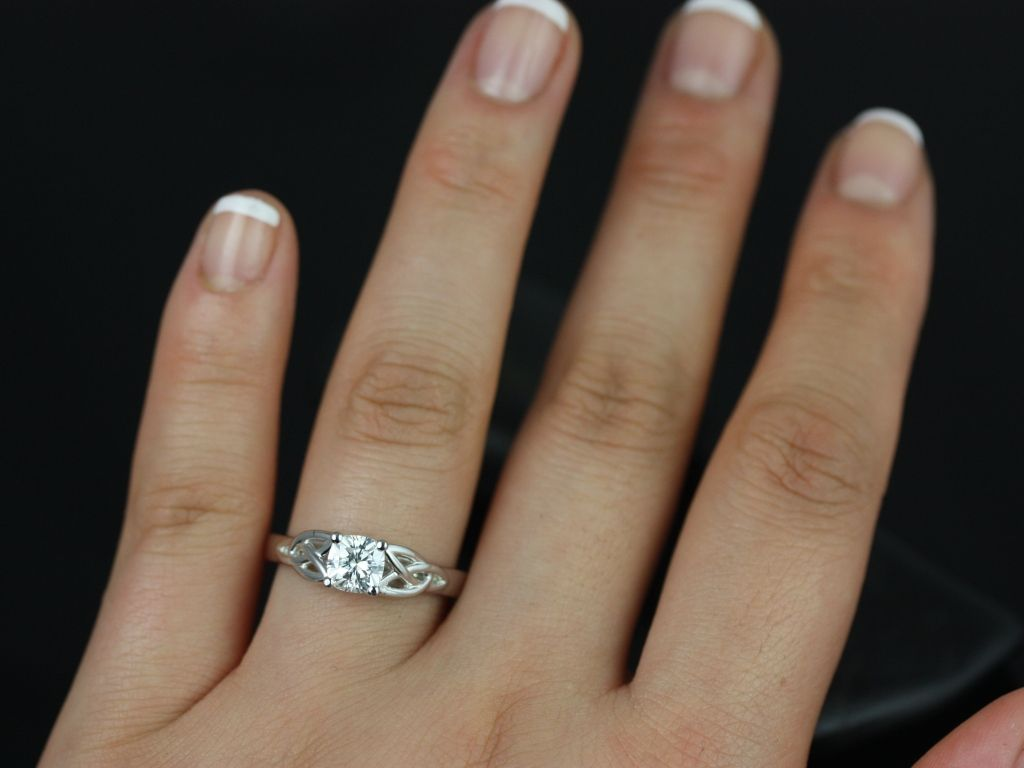 https://www.loveandpromisejewelers.com/media/catalog/product/cache/feefdef027ccf0d59dd1fef51db0610e/m/c/mccara_medio_size_fb_cushion_moissanite_white_gold_engagement_ring_5_.jpg