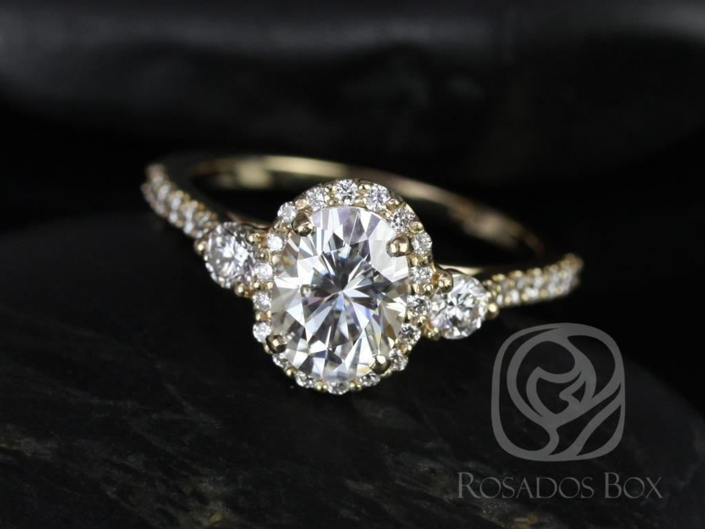 https://www.loveandpromisejewelers.com/media/catalog/product/cache/feefdef027ccf0d59dd1fef51db0610e/n/a/natalia_8x6mm_14kt_yellow_gold_oval_f1-_moissanite_and_diamonds_halo_engagement_ring_2_.jpg