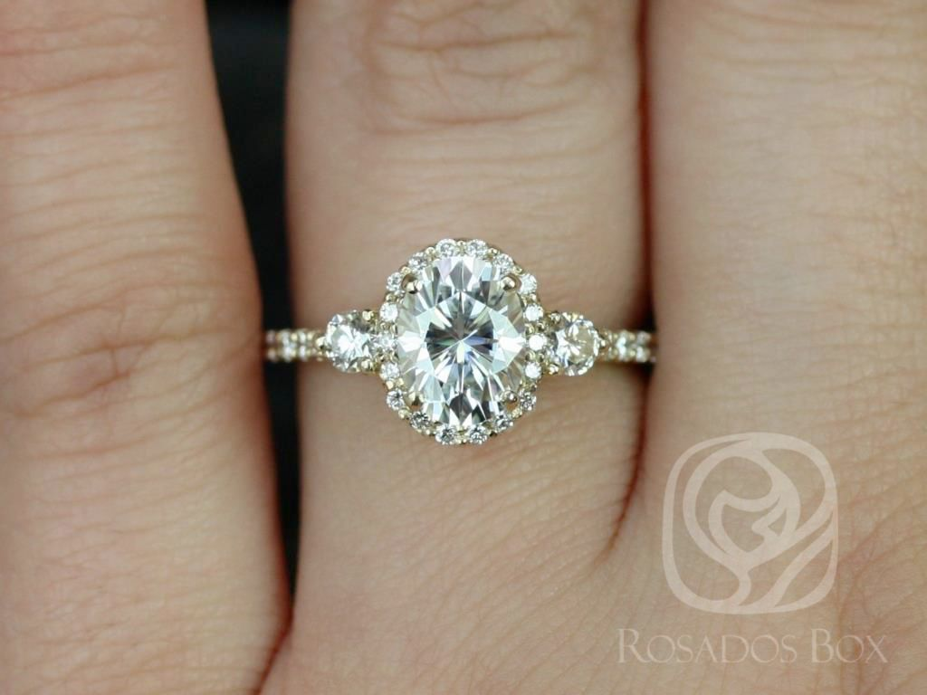 https://www.loveandpromisejewelers.com/media/catalog/product/cache/feefdef027ccf0d59dd1fef51db0610e/n/a/natalia_8x6mm_14kt_yellow_gold_oval_f1-_moissanite_and_diamonds_halo_engagement_ring_4_.jpg