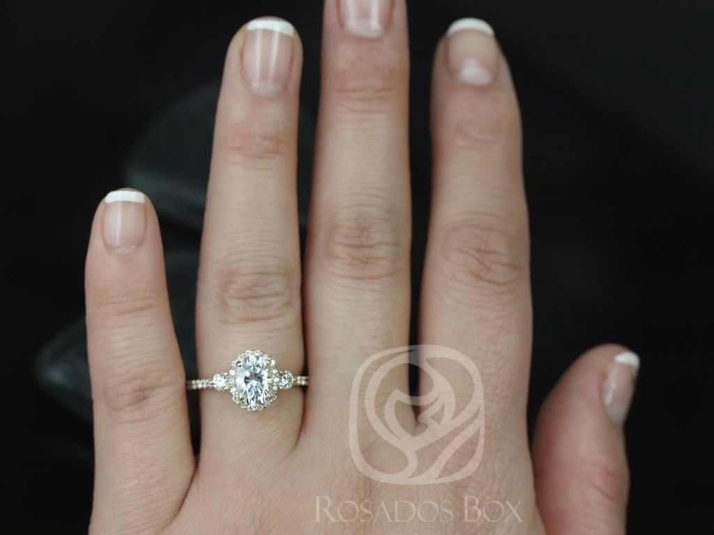 https://www.loveandpromisejewelers.com/media/catalog/product/cache/feefdef027ccf0d59dd1fef51db0610e/n/a/natalia_8x6mm_14kt_yellow_gold_oval_f1-_moissanite_and_diamonds_halo_engagement_ring_5_.jpg