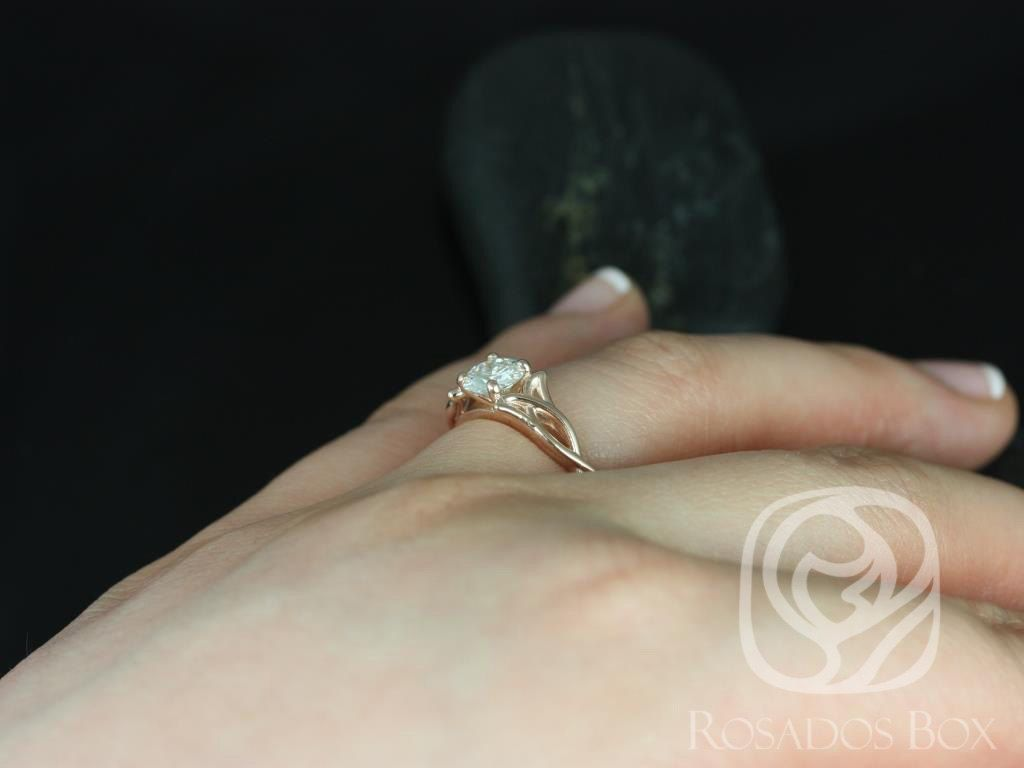 https://www.loveandpromisejewelers.com/media/catalog/product/cache/feefdef027ccf0d59dd1fef51db0610e/o/r/orla_6mm_14kt_rose_gold_round_fb_moissanite_celtic_knot_triquetra_engagement_ring5.jpg