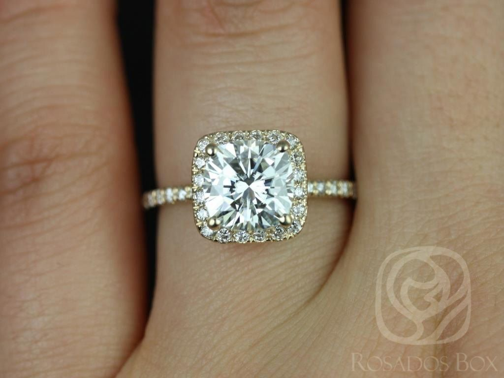 https://www.loveandpromisejewelers.com/media/catalog/product/cache/feefdef027ccf0d59dd1fef51db0610e/p/e/pernella_7mm_14kt_yellow_gold_cushion_fb_moissanite_and_diamonds_halo_engagement_ring_other_metals_and_stone_options_available_3wm.jpg