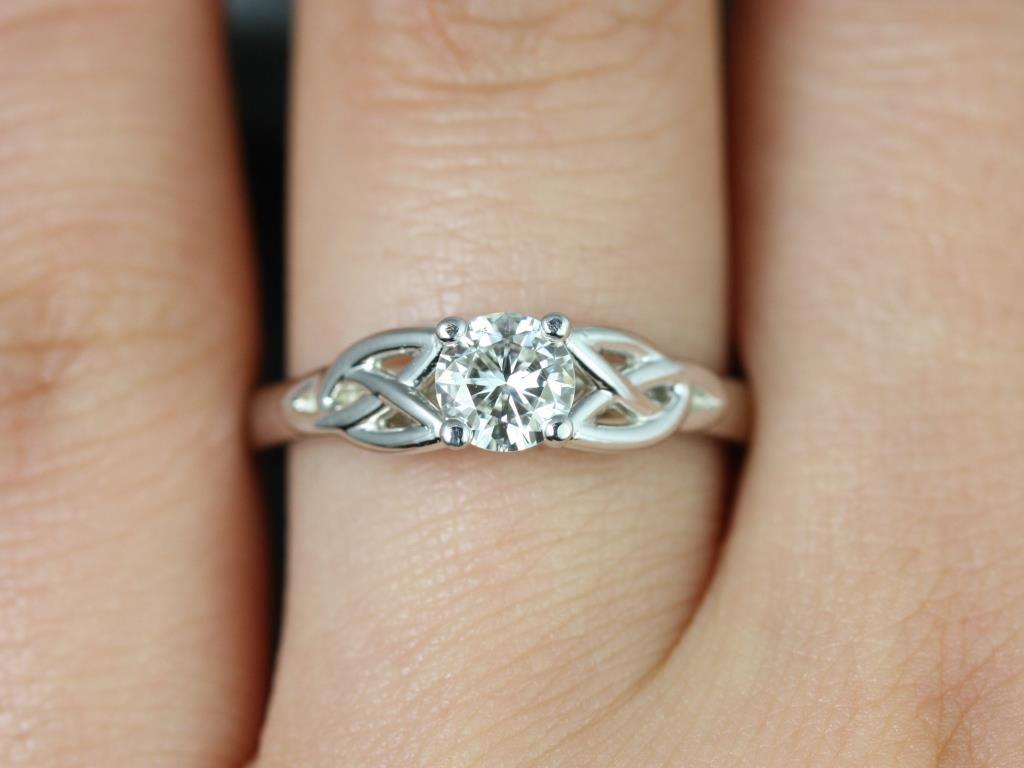 https://www.loveandpromisejewelers.com/media/catalog/product/cache/feefdef027ccf0d59dd1fef51db0610e/p/e/petite_mccara_fb_moissanite_white_gold_engagement_ring_4_.jpg