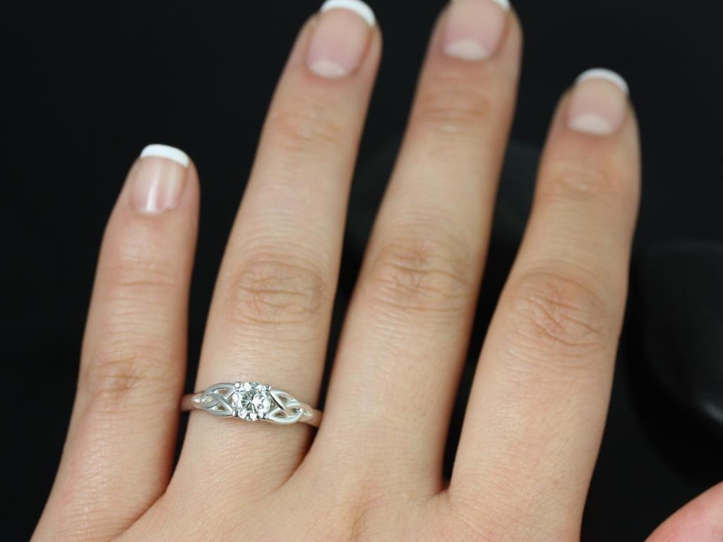 https://www.loveandpromisejewelers.com/media/catalog/product/cache/feefdef027ccf0d59dd1fef51db0610e/p/e/petite_mccara_fb_moissanite_white_gold_engagement_ring_5_.jpg