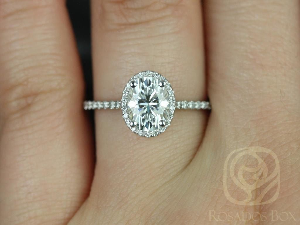 https://www.loveandpromisejewelers.com/media/catalog/product/cache/feefdef027ccf0d59dd1fef51db0610e/r/e/rebecca_8x6mm_14kt_white_gold_oval_fb_moissanite_and_diamond_halo_engagement_ring_other_metals_and_stone_options_available_3wm.jpg