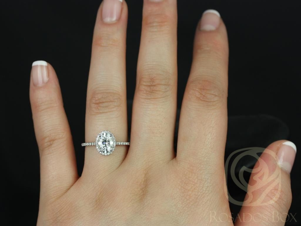 https://www.loveandpromisejewelers.com/media/catalog/product/cache/feefdef027ccf0d59dd1fef51db0610e/r/e/rebecca_8x6mm_14kt_white_gold_oval_fb_moissanite_and_diamond_halo_engagement_ring_other_metals_and_stone_options_available_4wm.jpg