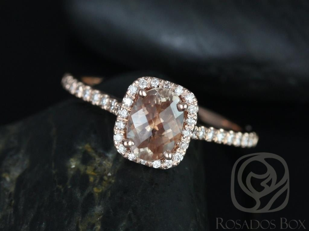 https://www.loveandpromisejewelers.com/media/catalog/product/cache/feefdef027ccf0d59dd1fef51db0610e/r/o/romani_7x5mm_14kt_rose_gold_oregon_sunstone_and_diamonds_cushion_halo_engagement_ring_other_center_stone_available_upon_request_1wm.jpg