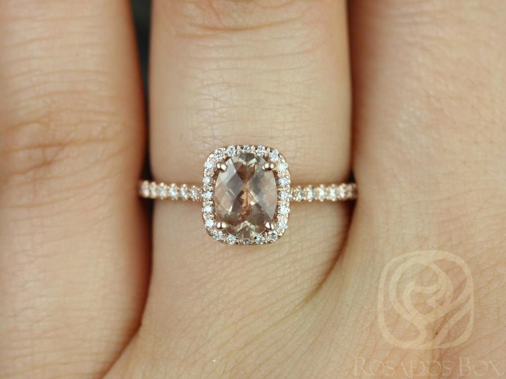 https://www.loveandpromisejewelers.com/media/catalog/product/cache/feefdef027ccf0d59dd1fef51db0610e/r/o/romani_7x5mm_14kt_rose_gold_oregon_sunstone_and_diamonds_cushion_halo_engagement_ring_other_center_stone_available_upon_request_3wm.jpg