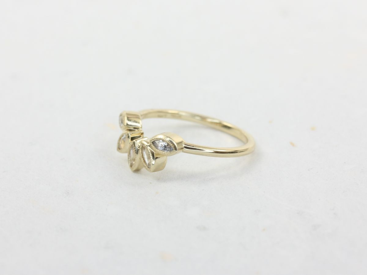 https://www.loveandpromisejewelers.com/media/catalog/product/cache/feefdef027ccf0d59dd1fef51db0610e/r/o/rosados_box_diamond_free_petunia_14kt_yellow_gold_matching_band_to_isla_7x5mm_white_sapphire_with_milgrain_wedding_band_4_.jpg